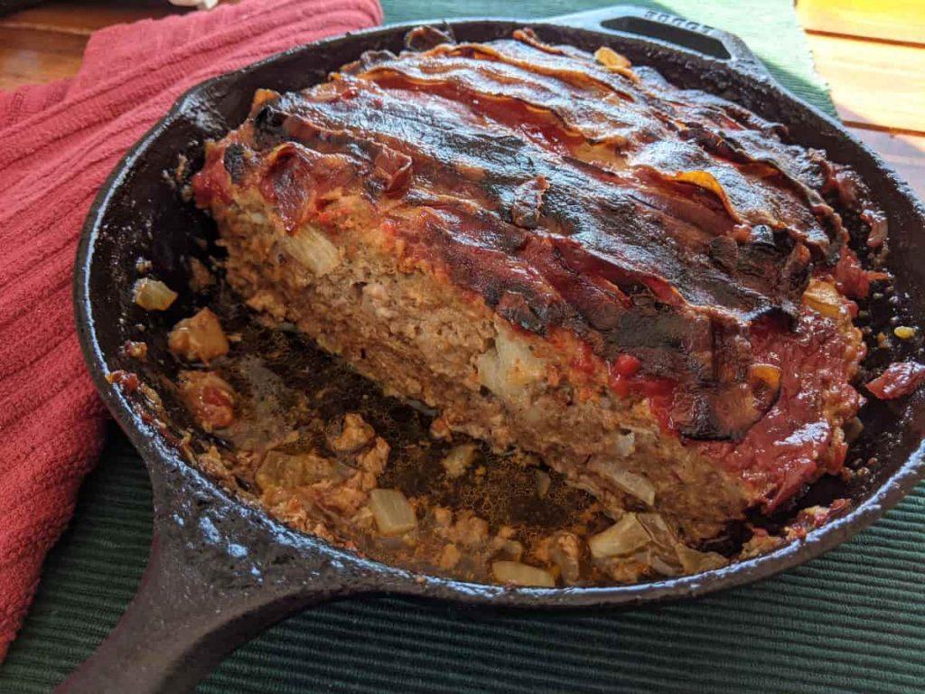 meatloaf cut in a skillet