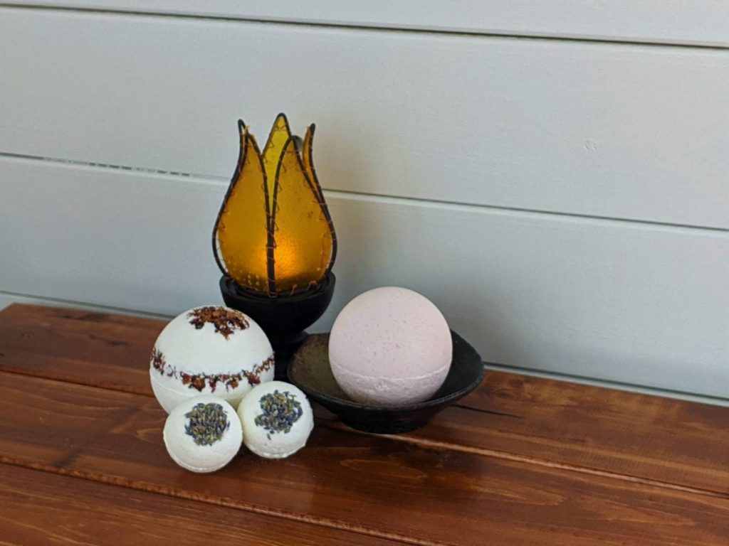 diy bath bombs on a table with a candle