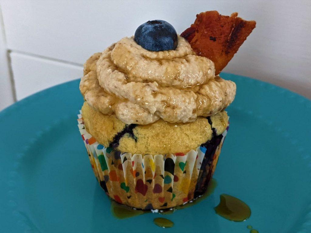 blueberry pancake cupcake sitting on a blue dish