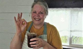 woman holding a jar of handmade bbq sauce