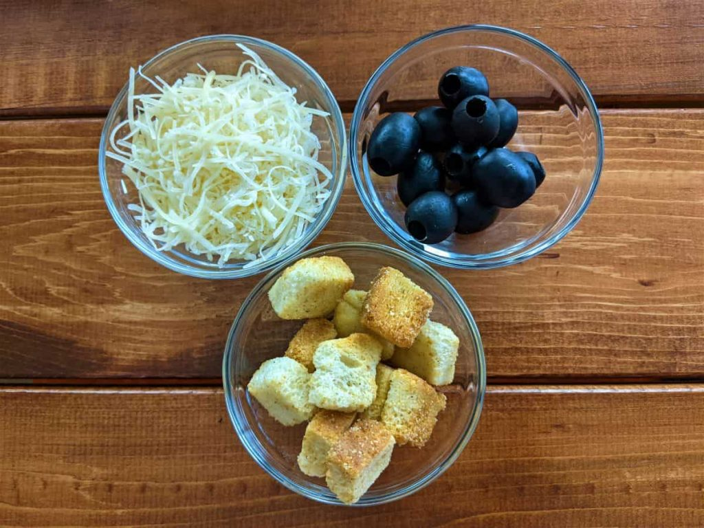 olives, croutons, and cheese ready to prep salad