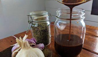 pouring homemade dressing into a jar