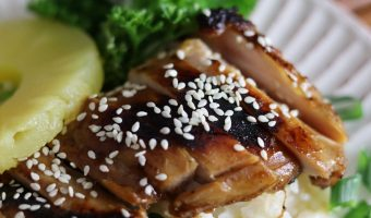 chicken cooked in teriyaki marinade on a plate